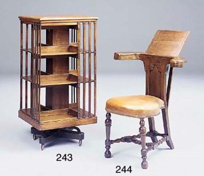 An oak revolving bookcase earl