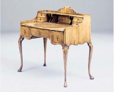 A walnut writing desk, early 2