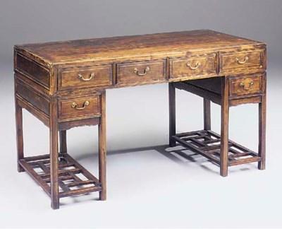 A Chinese elm pedestal desk, l