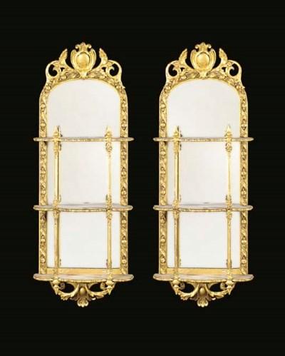 A pair of gilt gesso wall mirr