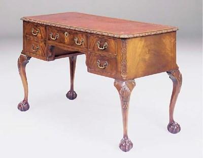 A mahogany kneehole writing de