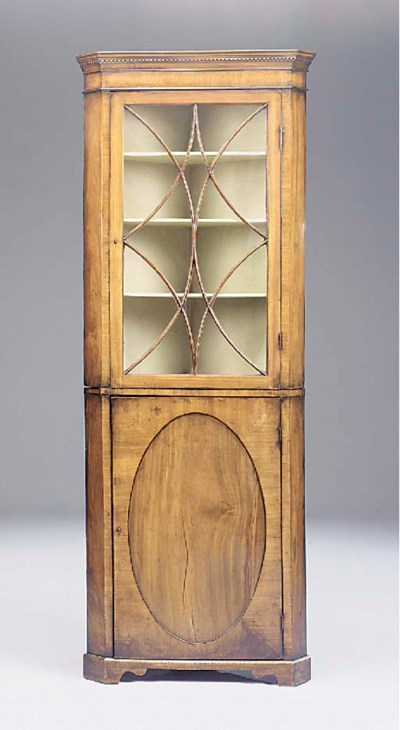 A mahogany standing corner cup