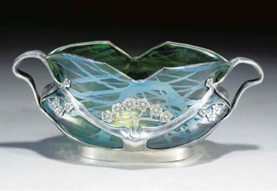 AN IRIDESCENT GLASS AND SILVER