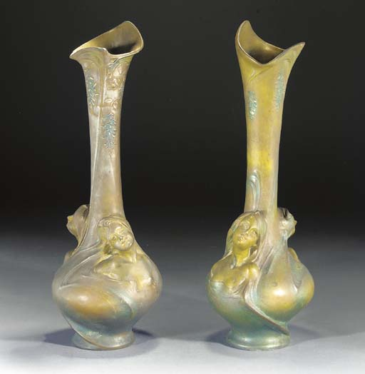 A PAIR OF PATINATED METAL VASES