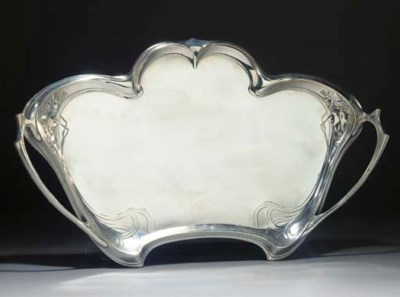 A SILVERED METAL TRAY