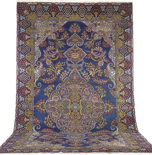 A fine Kirman Laver carpet, So