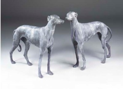 A pair of lead models of greyh