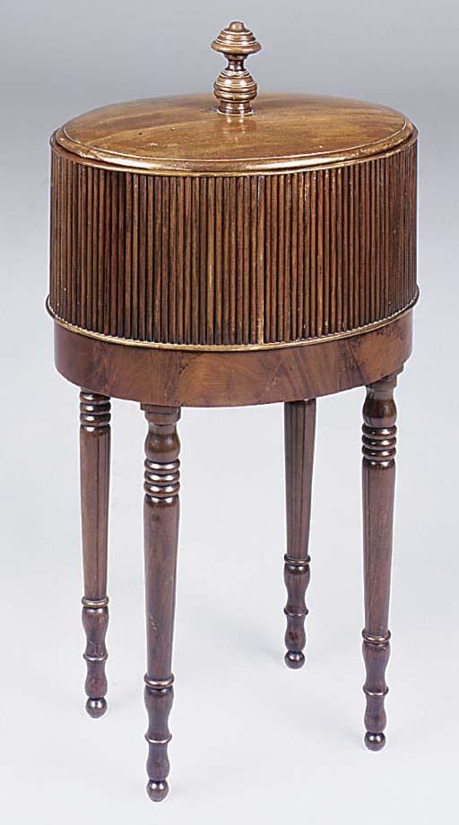 A mahogany oval cellarette, 19