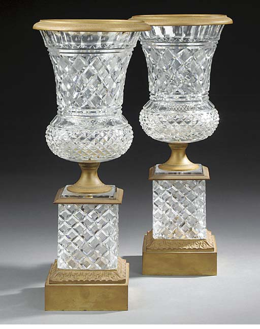 A pair of gilt bronze and hob-nail cut glass vases