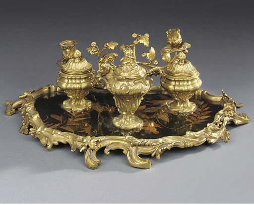 A gilt bronze and parcel-gilt