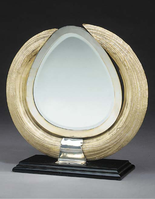 A hippopotamus tusk and silver