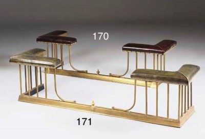 A brass club fender, 20th cent