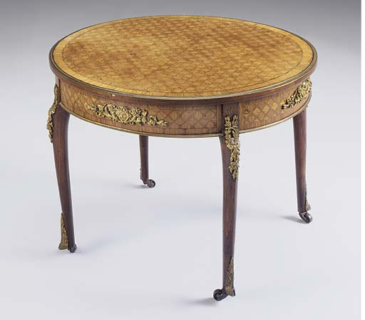 A French kingwood, mahogany, parquetry and gilt metal mounted circular centre table, early 20th century