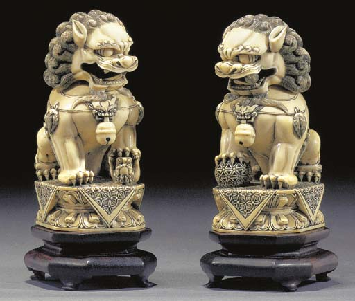 A PAIR OF CHINESE IVORY BUDDHI
