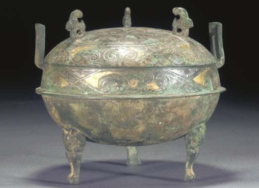 A SILVER AND GILT INLAID BRONZ