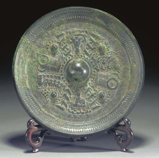 A CHINESE BRONZE MIRROR HAN DY