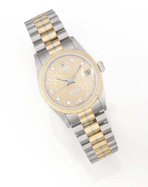 ROLEX, A MID-SIZE 18ct. YELLOW