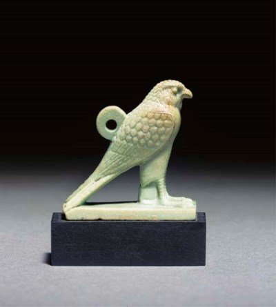AN EGYPTIAN PALE GREEN GLAZED
