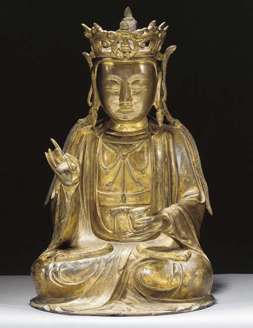 A Chinese gilt bronze figure o