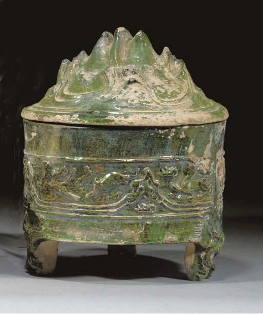 A Chinese green glazed tripod