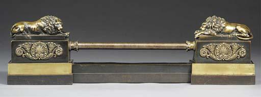 A Restauration brass adjustabl