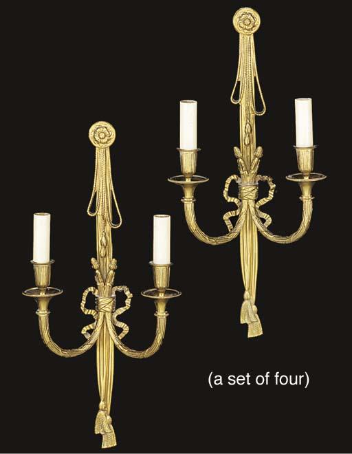 A set of four gilt metal twin