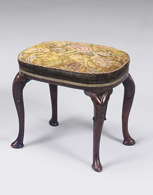 A Queen Anne walnut oval stool