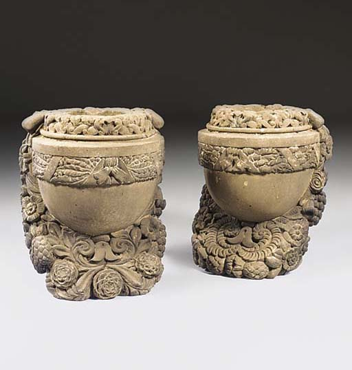A pair of English carved stone