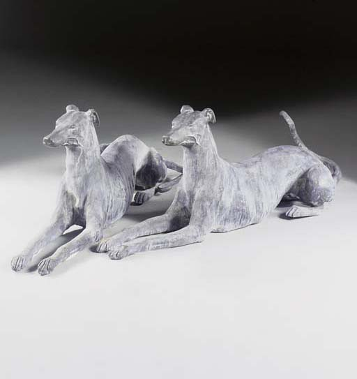 A pair of lead greyhounds