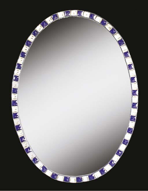 AN OVAL BLUE CUT GLASS MIRROR
