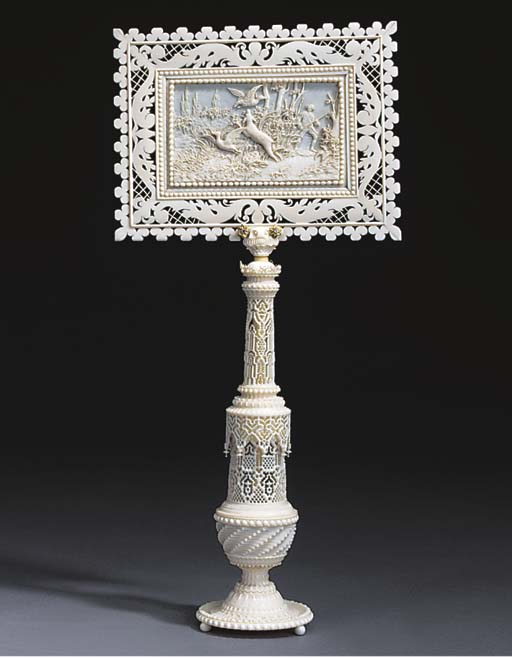 A French carved ivory candle s