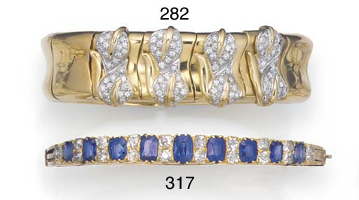 A diamond set flexible bangle,