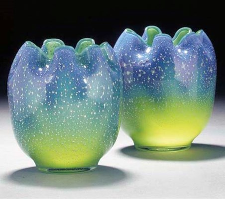 A pair of bubbled glass vases