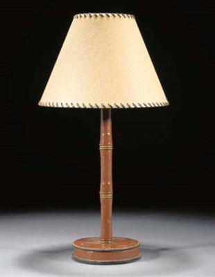 A leather and brass table lamp