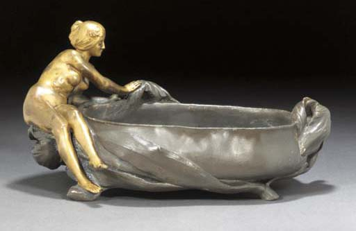 A gilt bronze and pewter figur