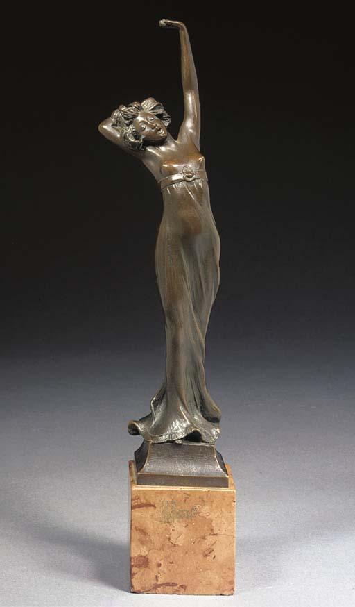An Art Nouveau patinated figur