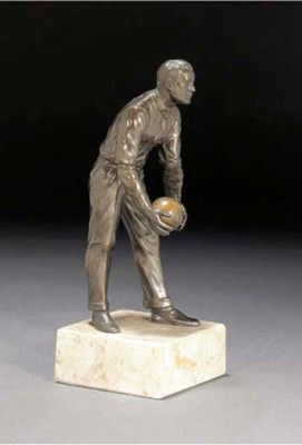 A patinated spelter and turned