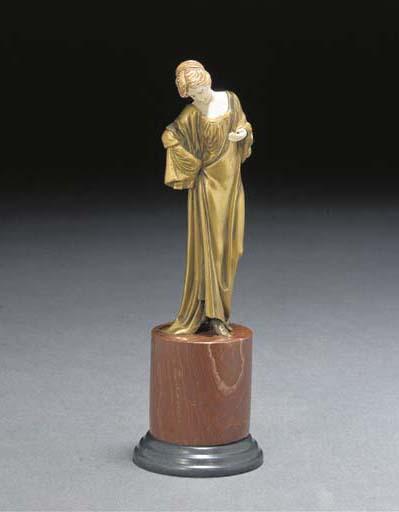 A gilt bronze and ivory figure