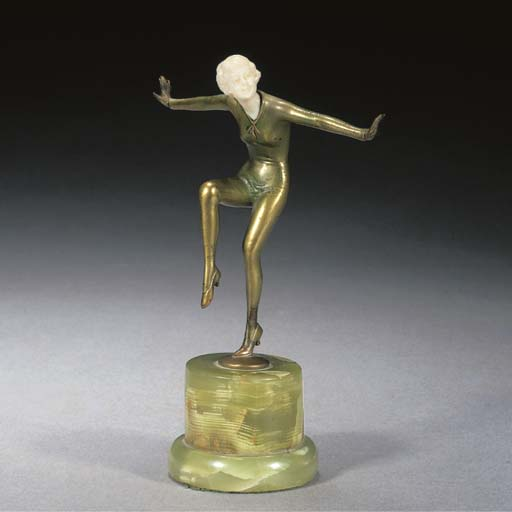 A cold-painted bronze and ivor