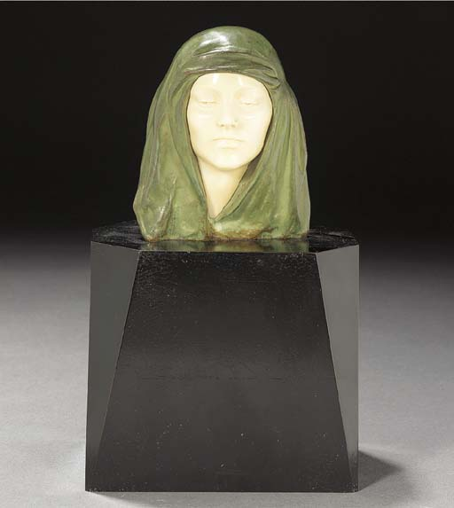 A green patinated bronze and i