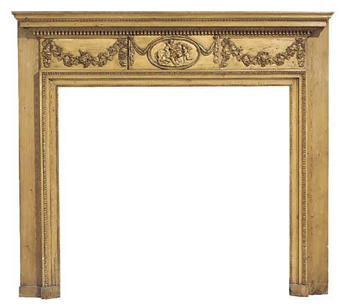 A late Victorian or Edwardian carved pine chimneypiece