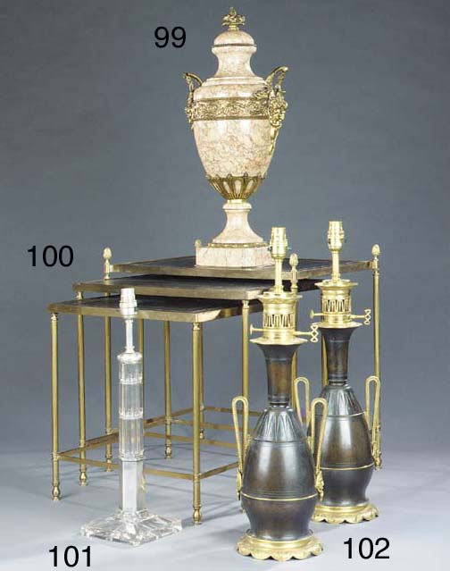 A nest of three brass occasional tables
