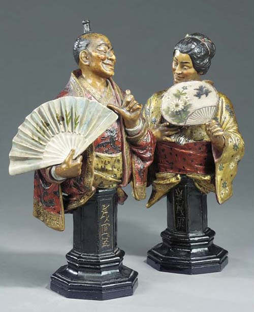 A pair of Austrian painted terracotta busts