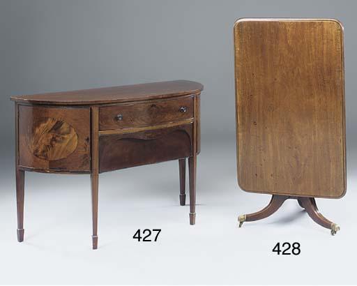 A mahogany tripod breakfast table