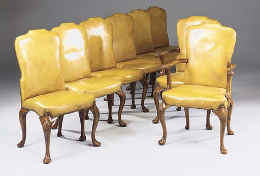 A set of eight walnut dining chairs