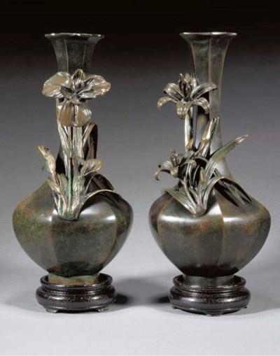 A pair of bronze bottle vases