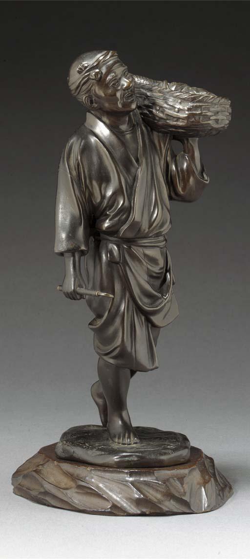 A bronze model of a fisherman