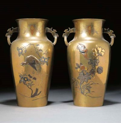 A pair of polished bronze vase