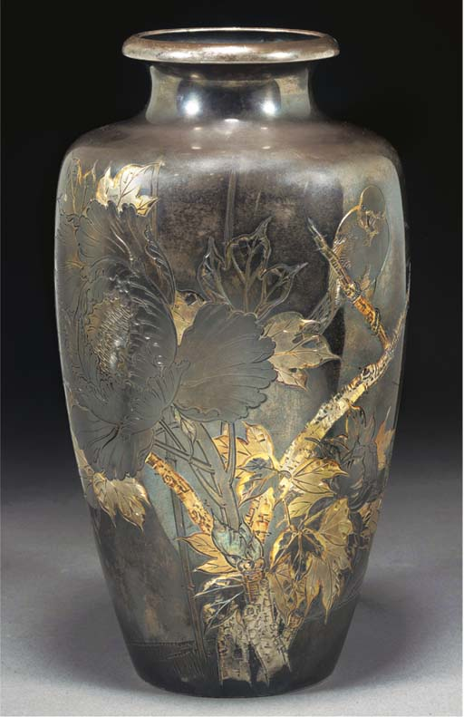 A silver and gilt inlaid vase