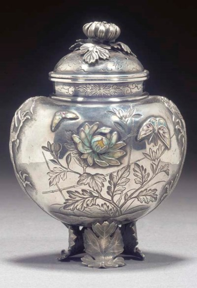 A silver and enamel koro and c